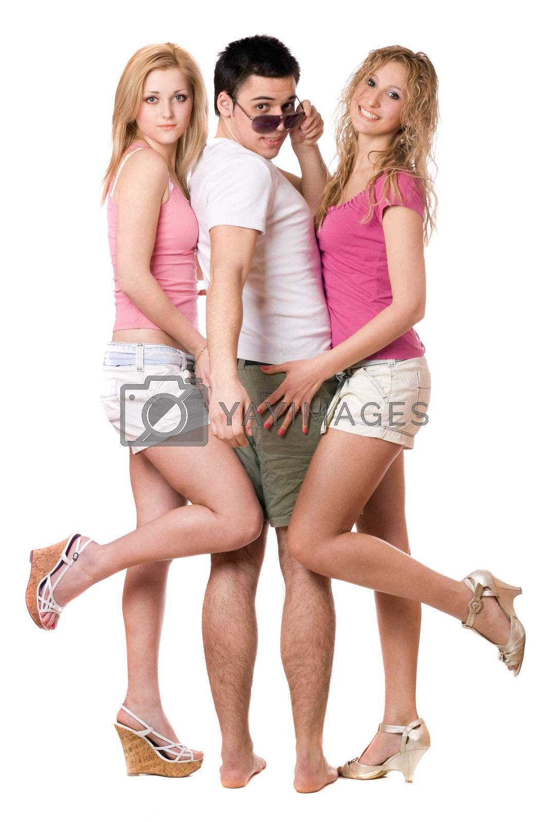 Handsome young man and two sexy girls. Isolated