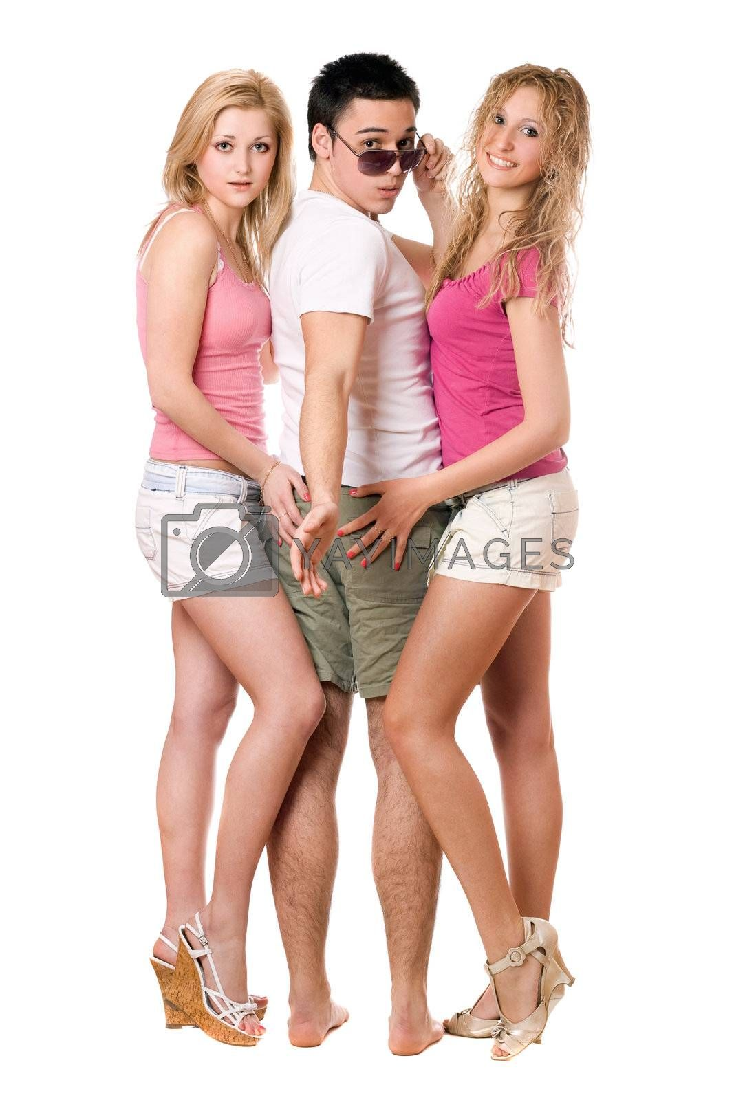 Handsome young man and two beautiful girls. Isolated