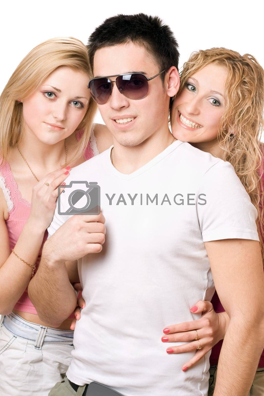 Portrait of a two smiling blonde women with handsome young man