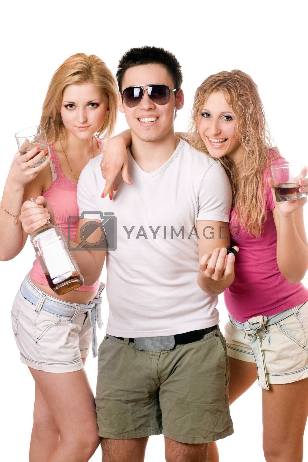 Two beautiful blonde women and young man with a bottle