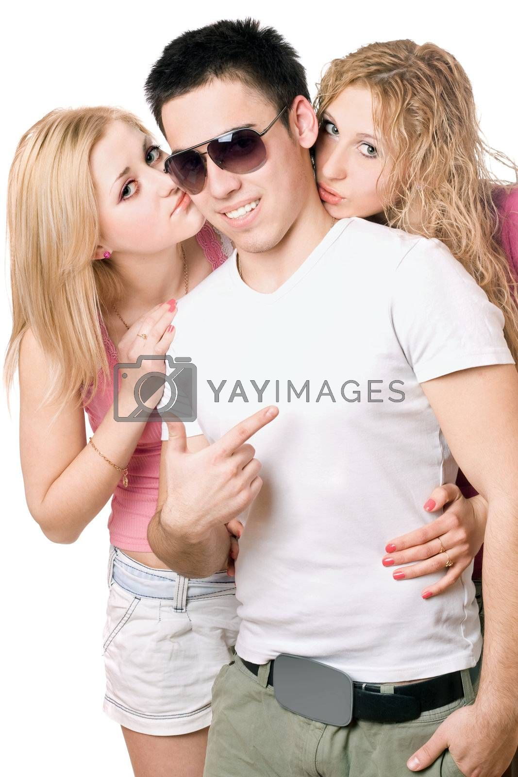 Two attractive blonde kissing handsome young man