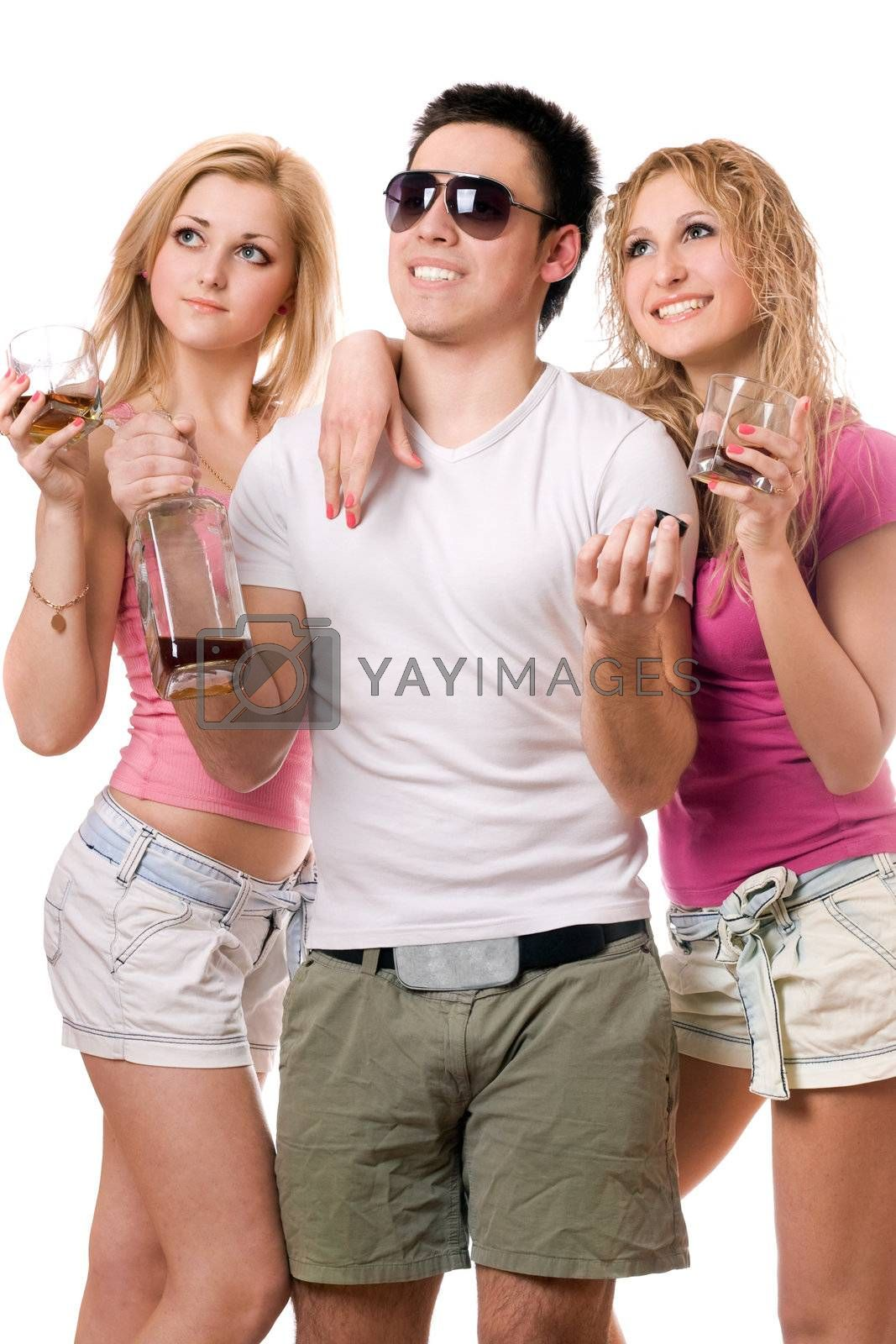 Two smiling blonde woman and young man with a bottle