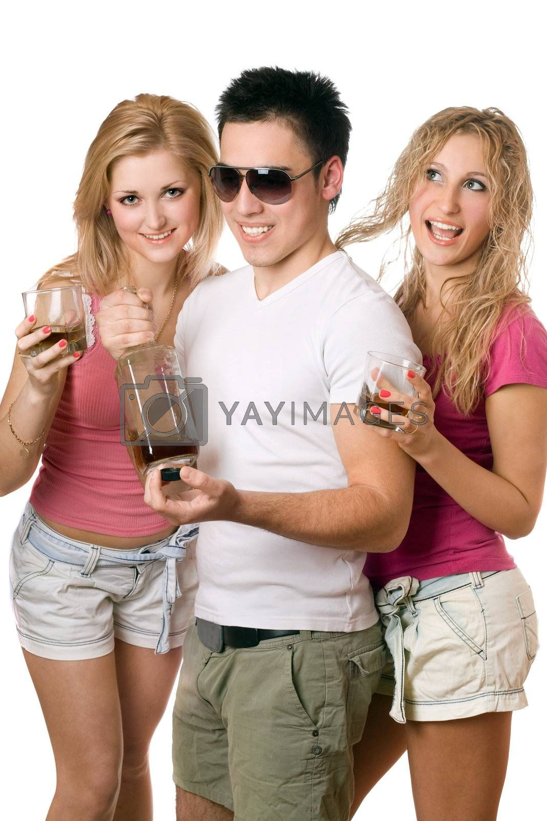 Two playful blonde woman and young man with a bottle