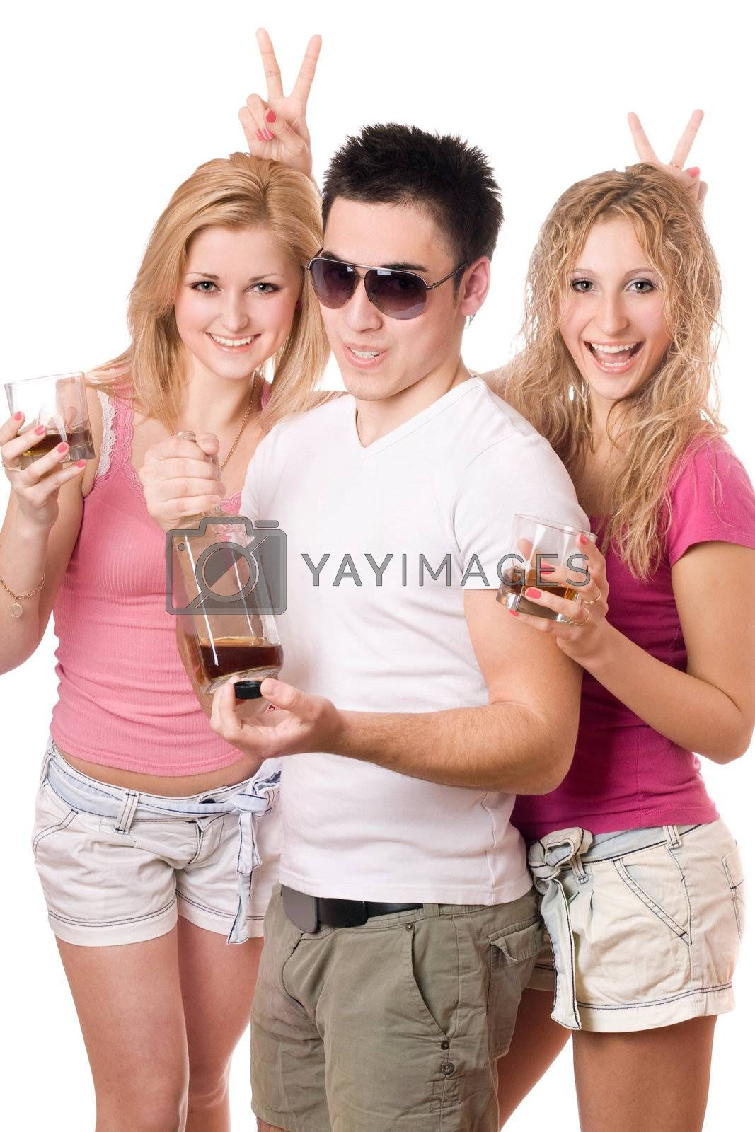 Two joyful blonde woman and young man with a bottle