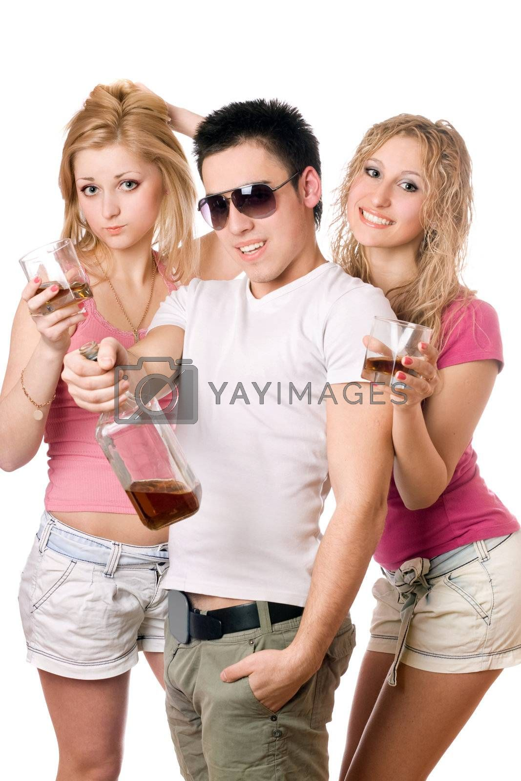 Cheerful young people with a bottle of whiskey. Isolated
