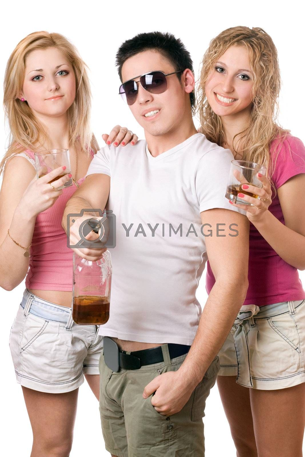 Smiling young people with a bottle of whiskey. Isolated