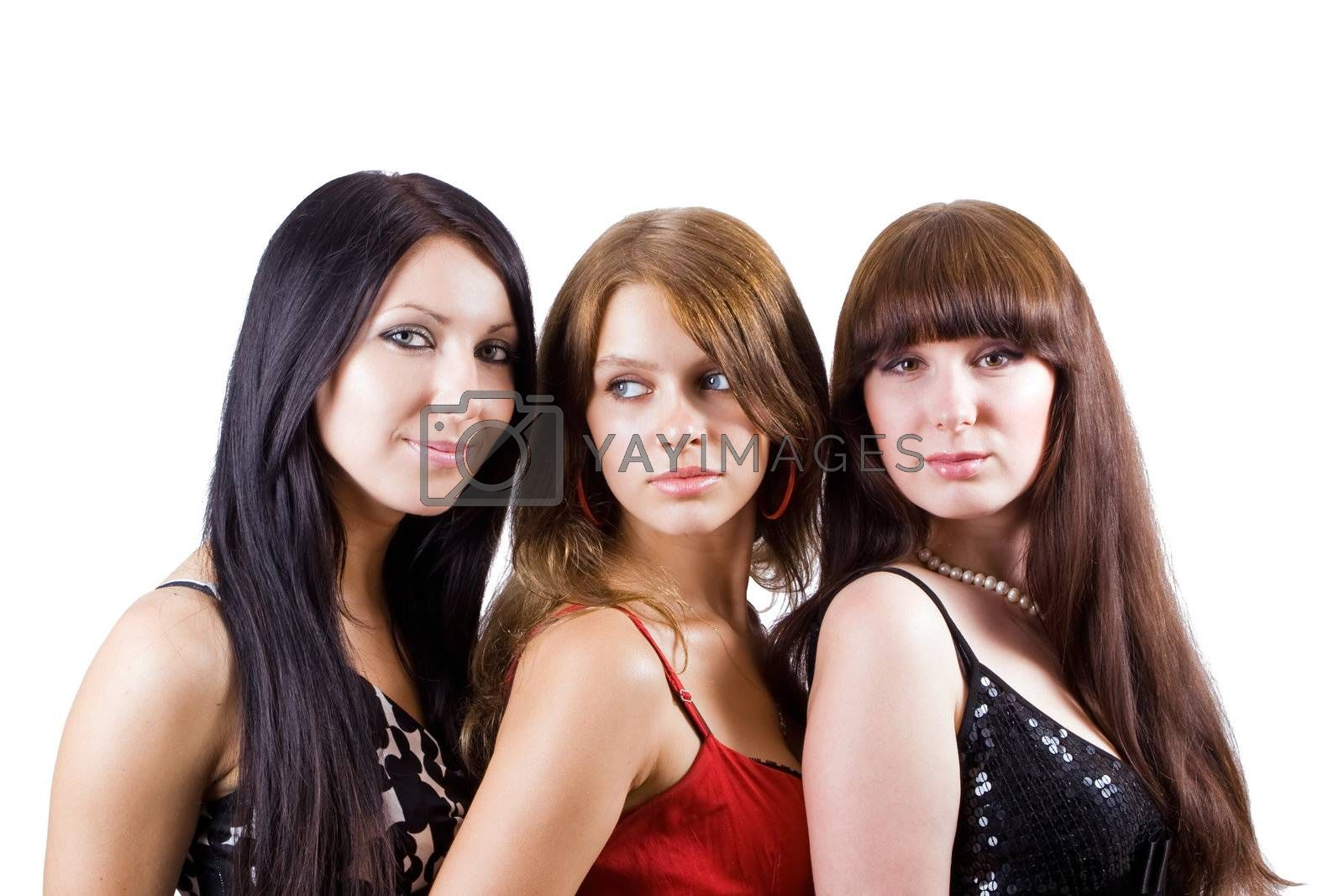 Portrait of three beautiful young women. Isolated