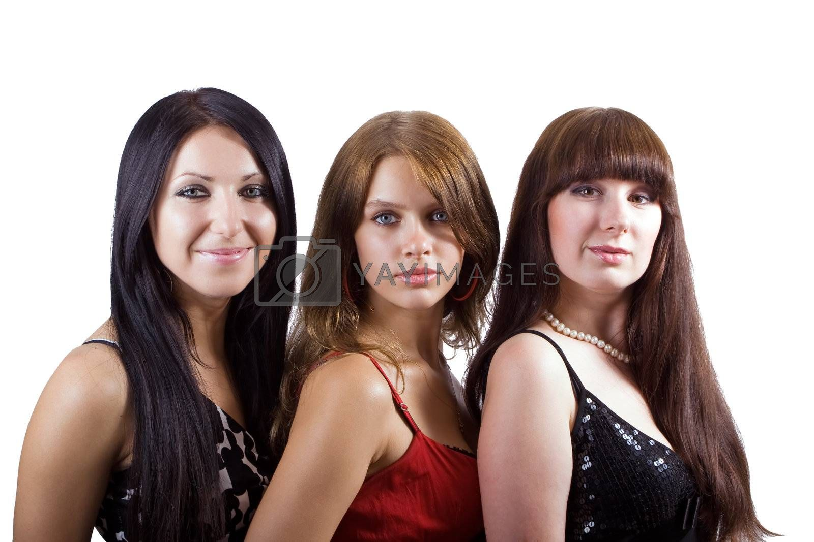 Portrait of three beautiful young women. Isolated 2