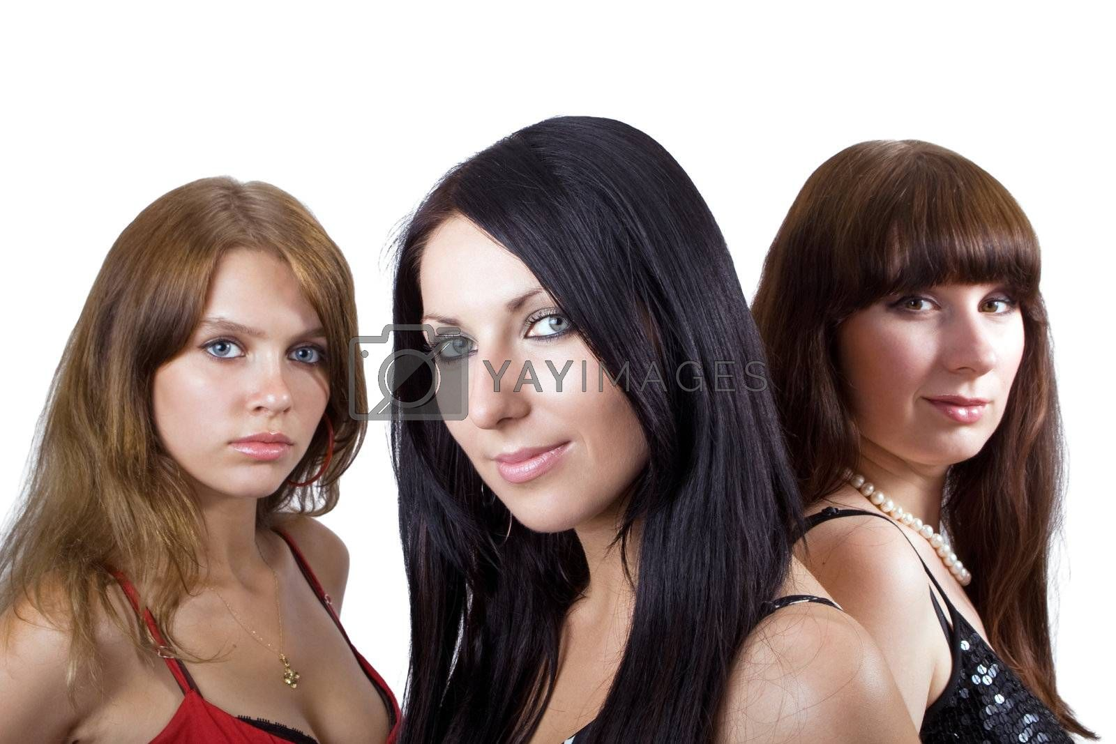Portrait of three beautiful young women. Focus on the central girl