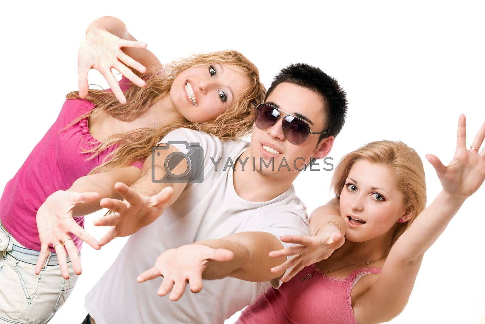 Portrait of two playful blonde with handsome young man. Isolated