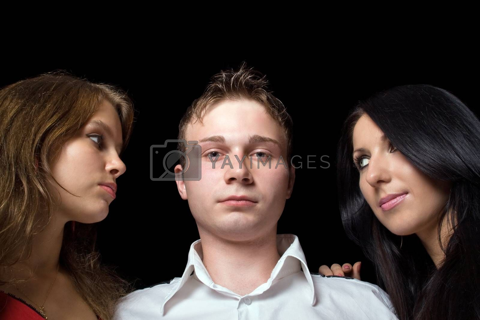 portrait of the young man and two young women. Isolated