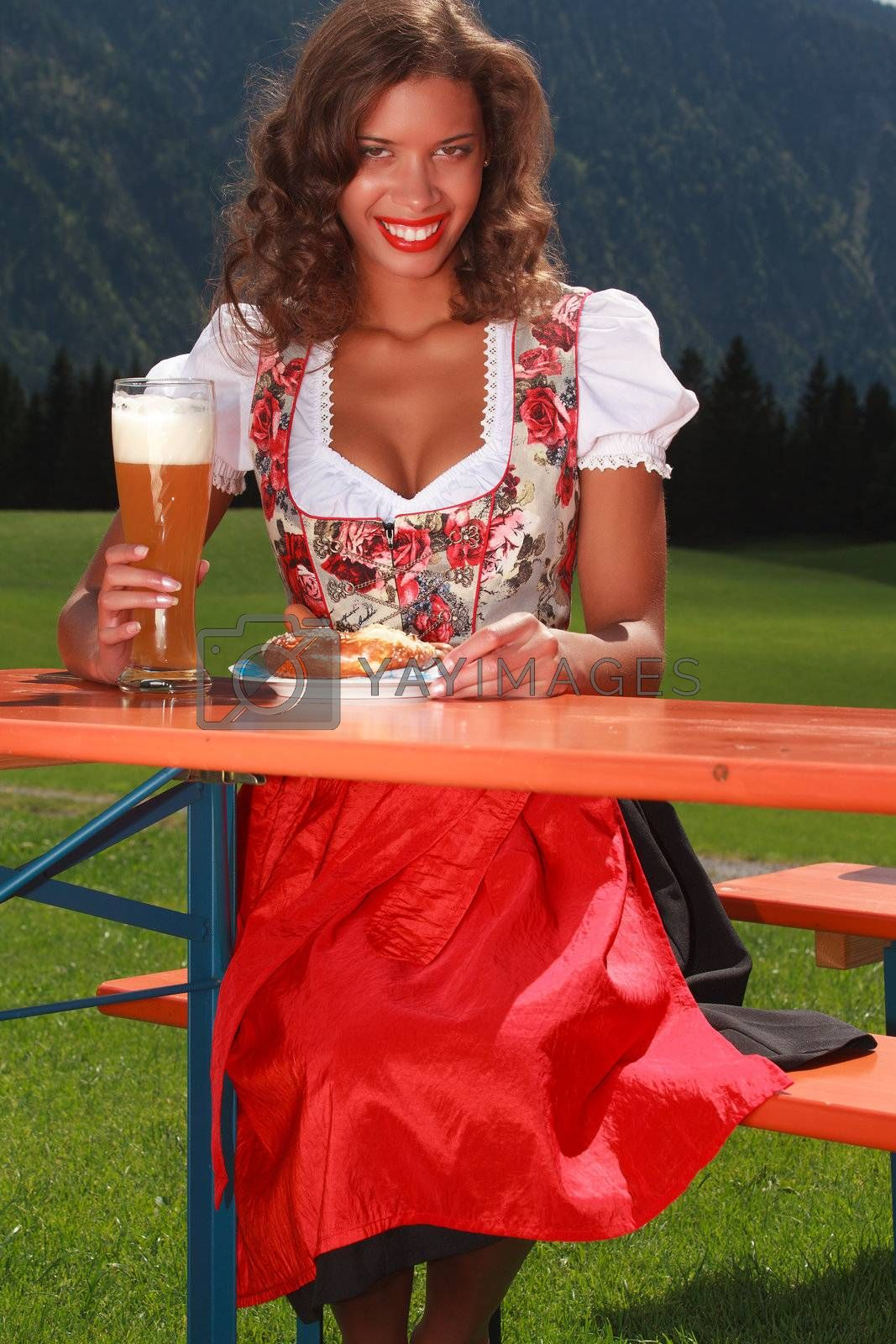 Bavarian girl eat and drink when in costume