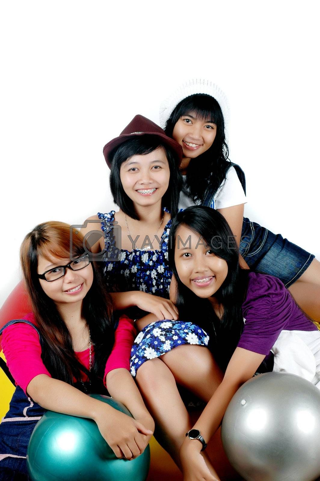 Four teens cheerful girls  photographed  with  white background