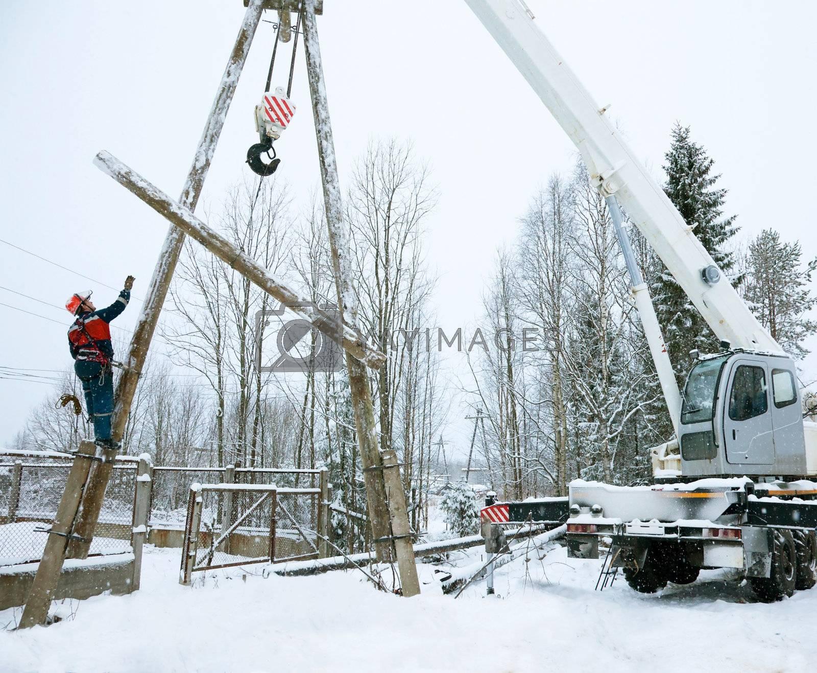 Repair power lines in winter in heavy snowfall