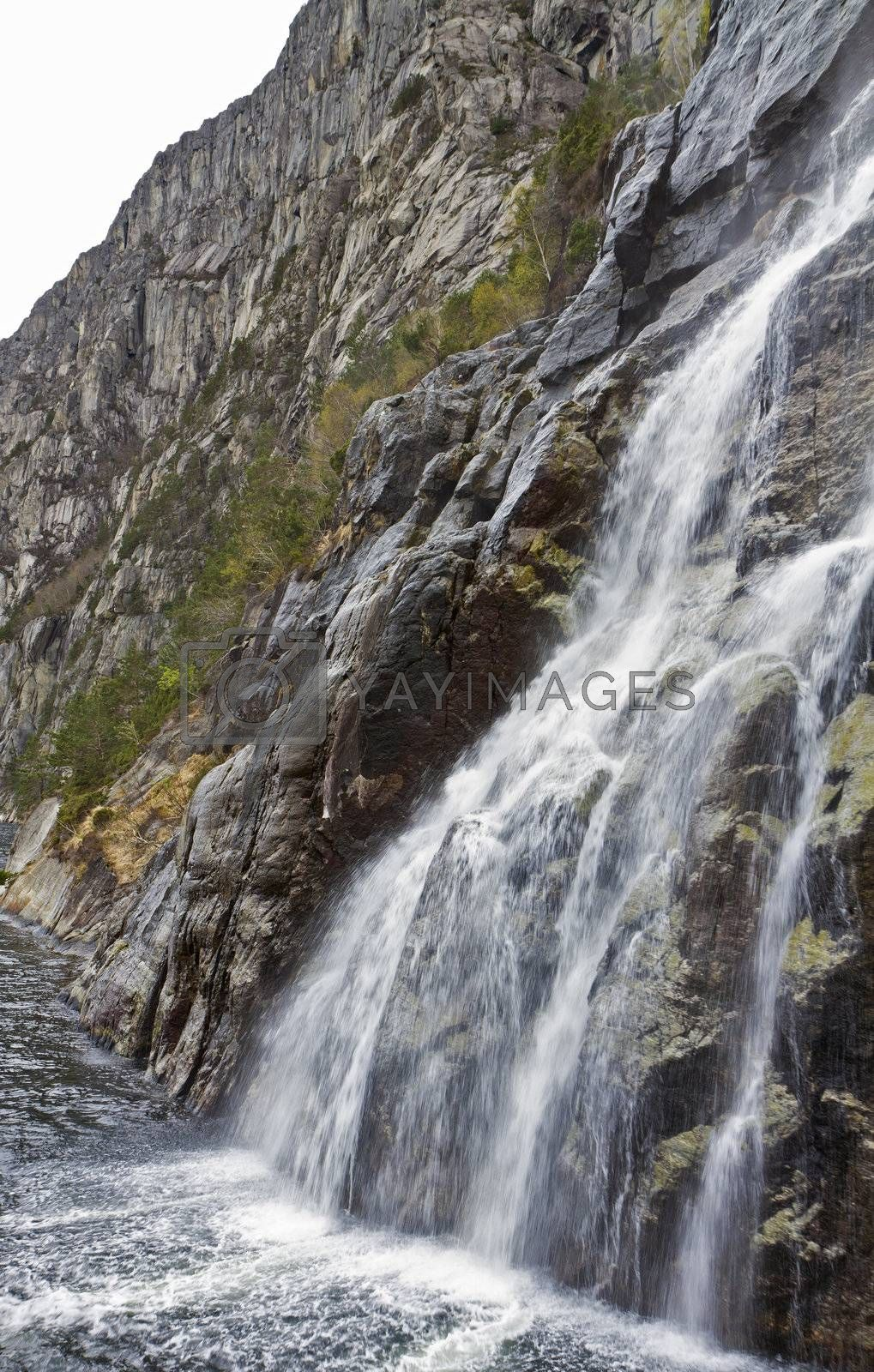 steep mountain with waterfall in norway, europe