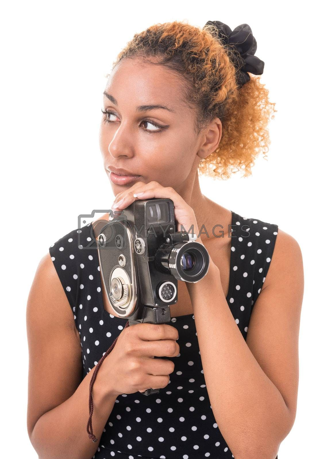 portrait of a young woman with a camera in hand, in a retro style