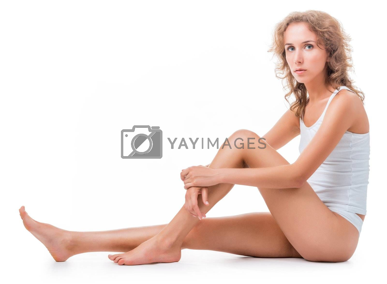 figure of a seated young woman in lingerie. Isolation on white background