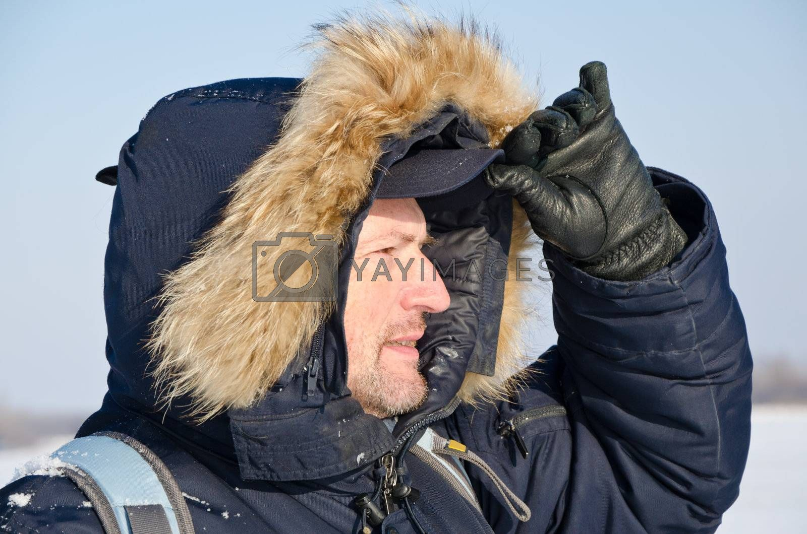 Portrait of a traveler in winter clothes in an outdoor