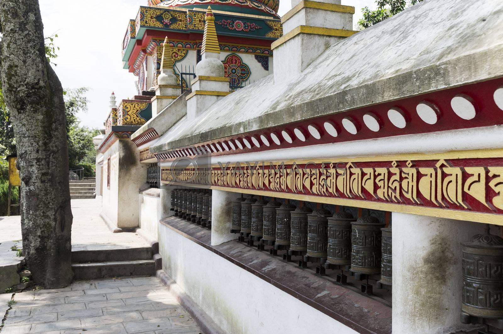 prayer wheels in row in kathmandu, nepal, asia
