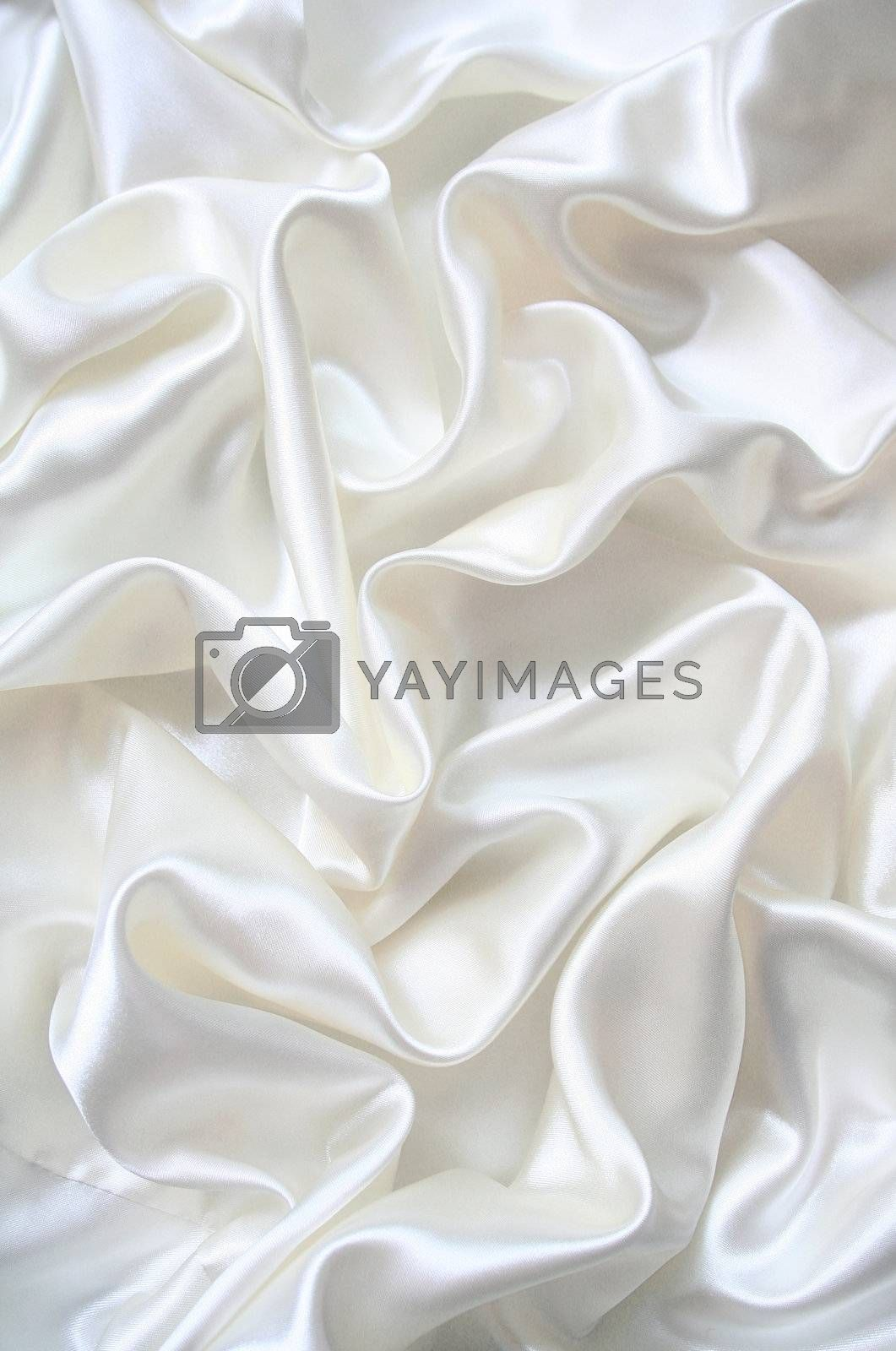 Smooth elegant white silk can use as wedding background by oxanatravel
