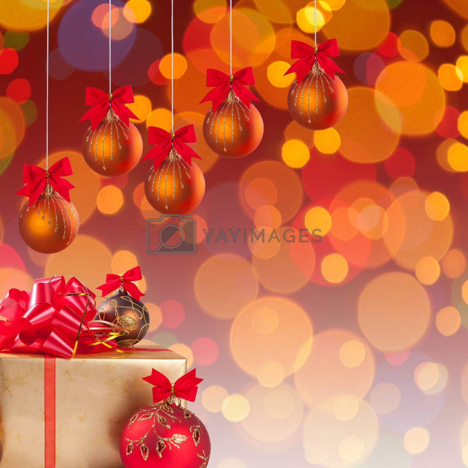Cristmas gifts and  balls on ribbon on festive background