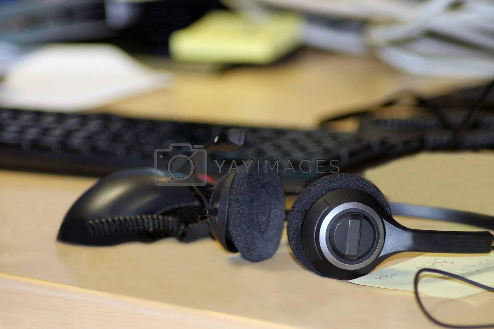 Headset on office desk by speedfighter