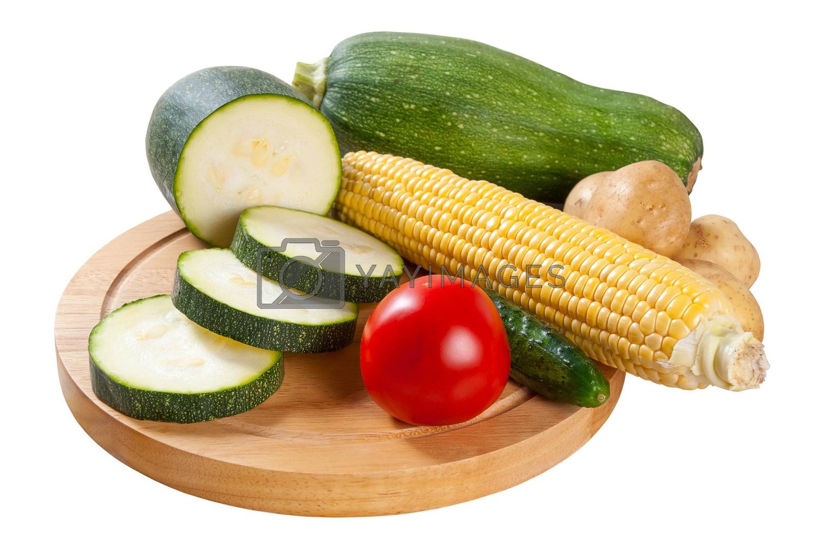 Whole and sliced different vegetables isolated on white backround