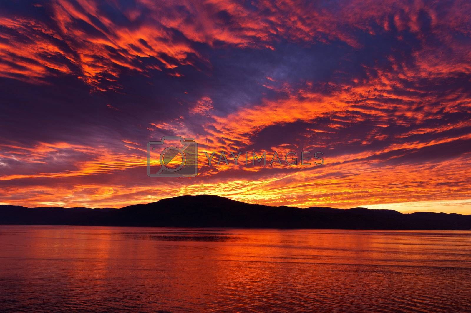 Amazing fiery burning evening sky by 3523Studio