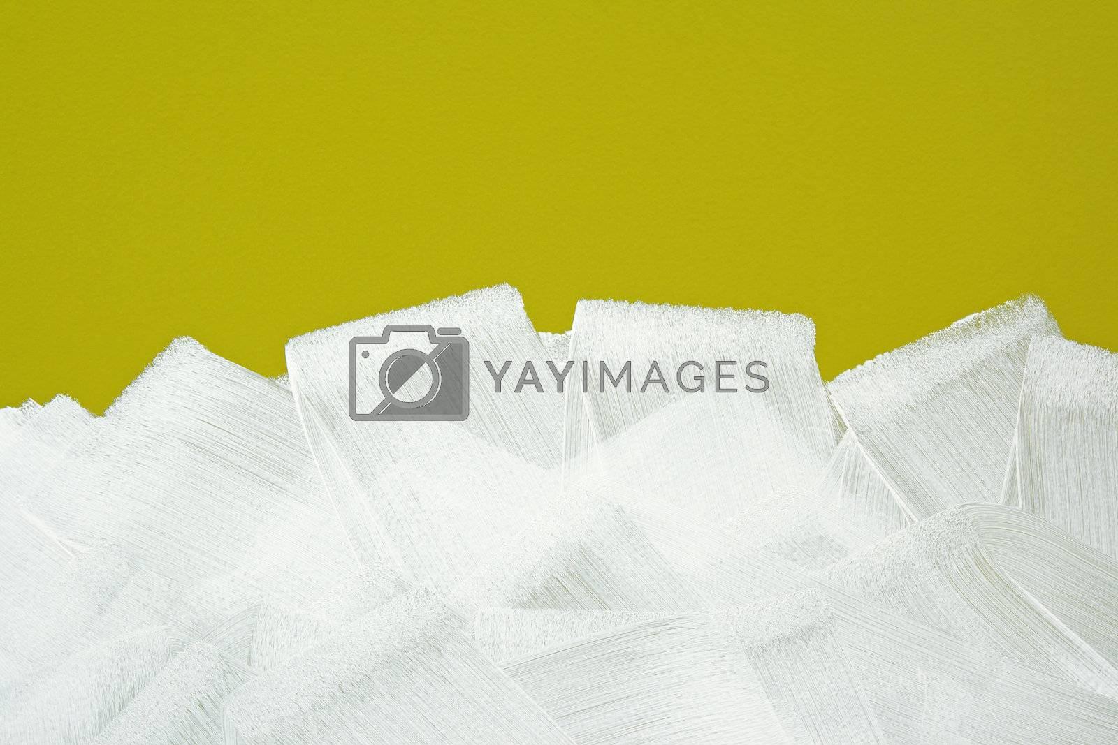 White brush strokes texture on yellow wall by anikasalsera