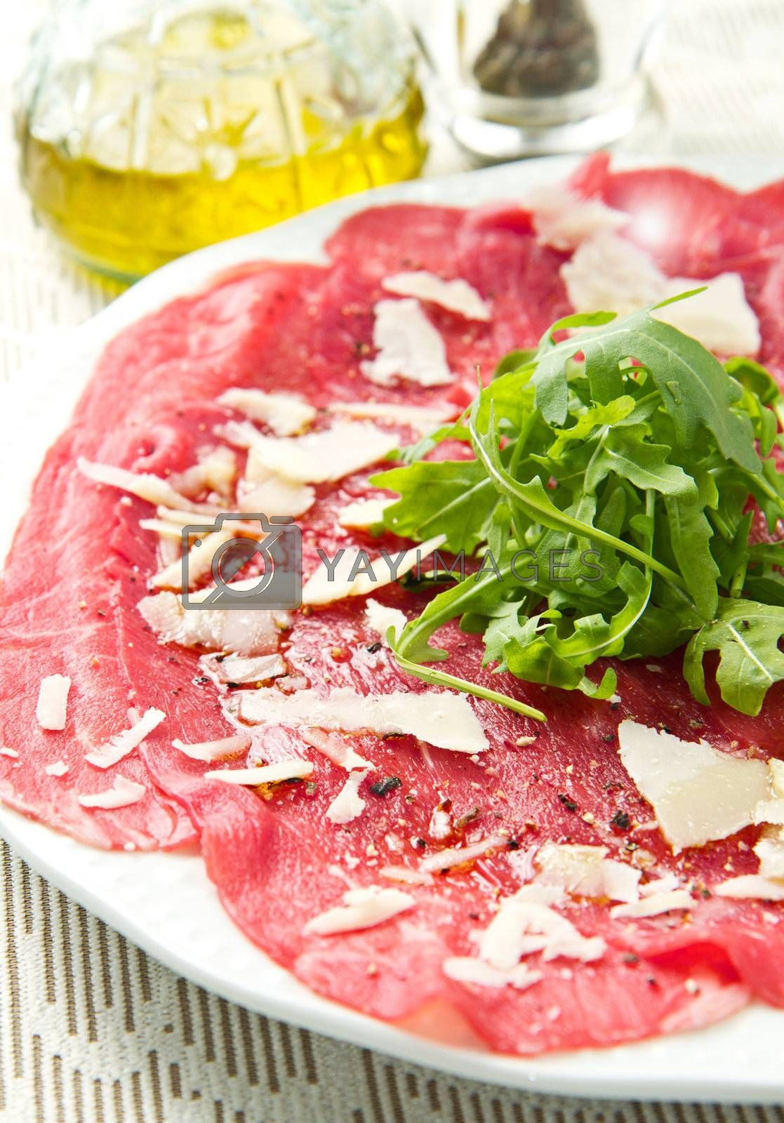 carpaccio of beef on arugula  by lsantilli