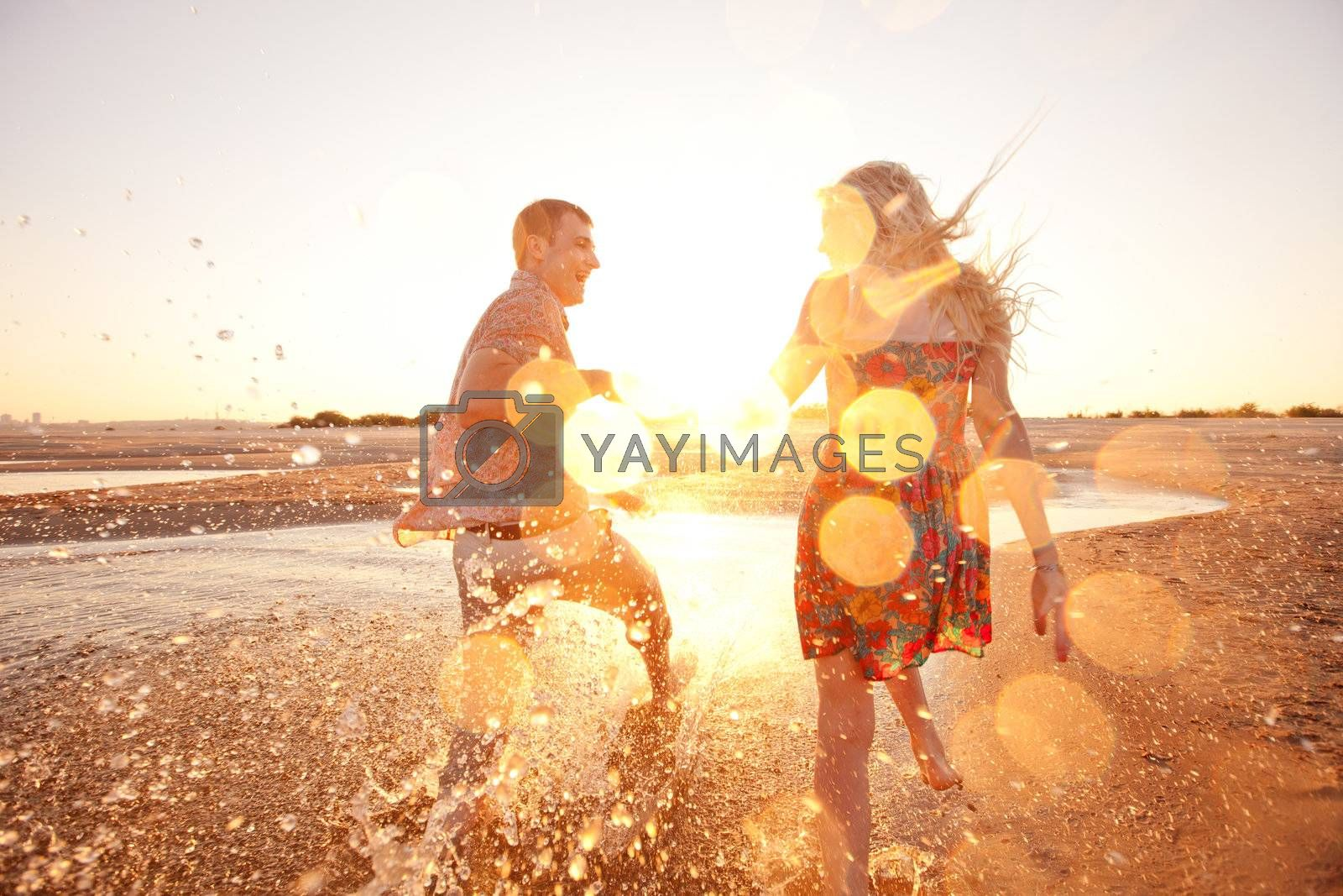 couple running on the beach by vsurkov