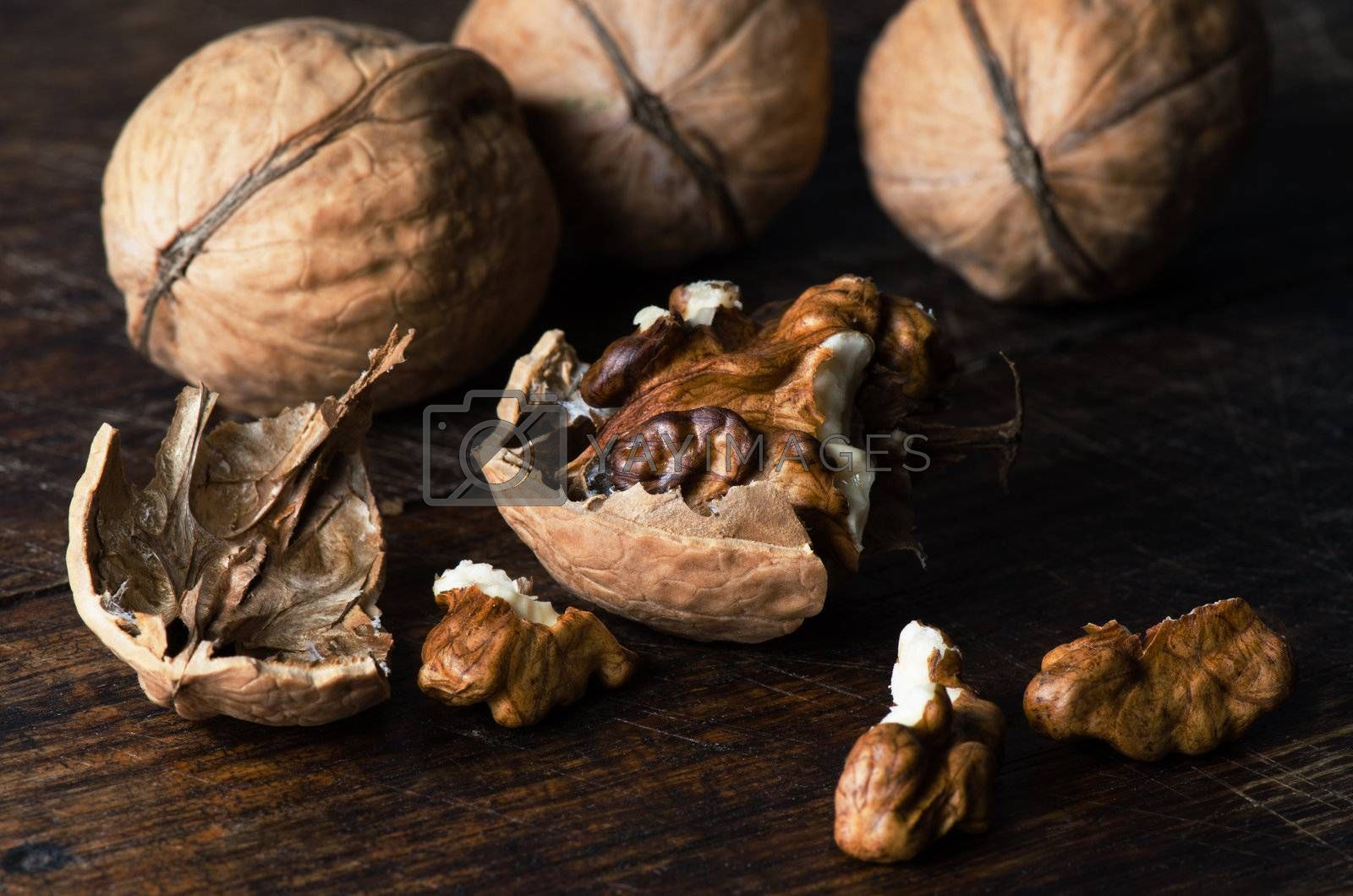 Walnuts on wooden table by Nanisimova
