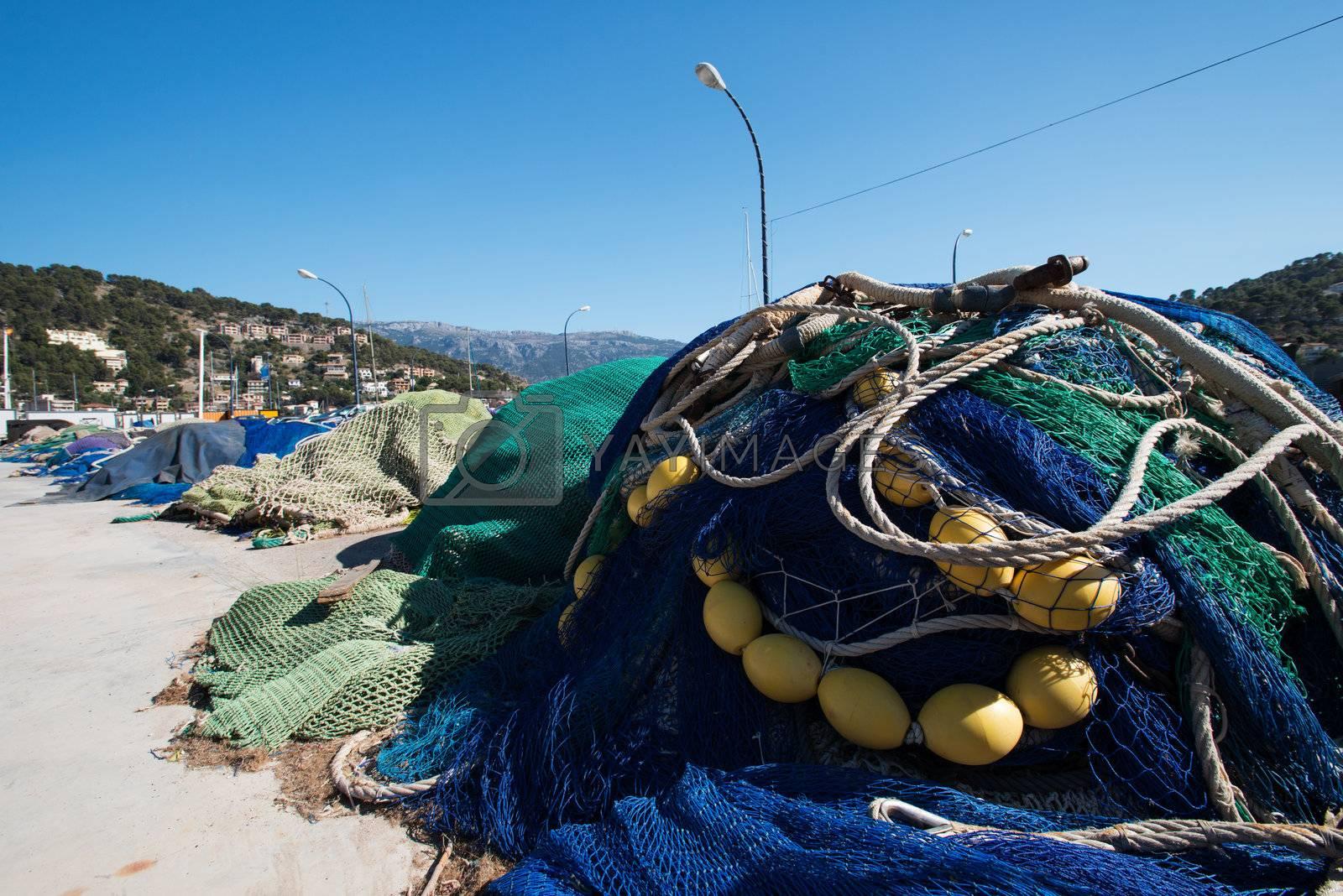 Fishing nets on a pier close up by Nanisimova