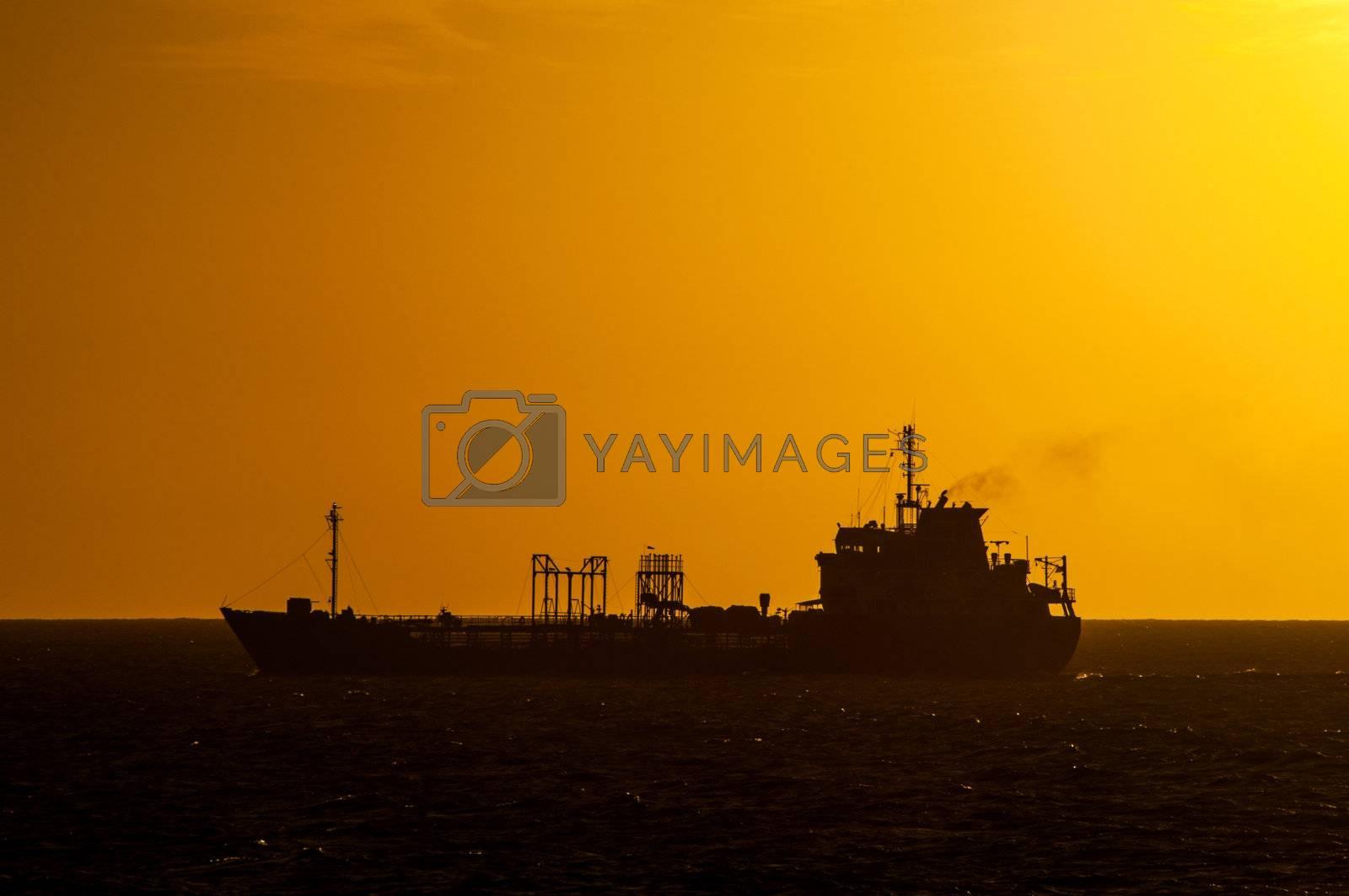 Dark Boat Silhouette at Sunset by jkraft5