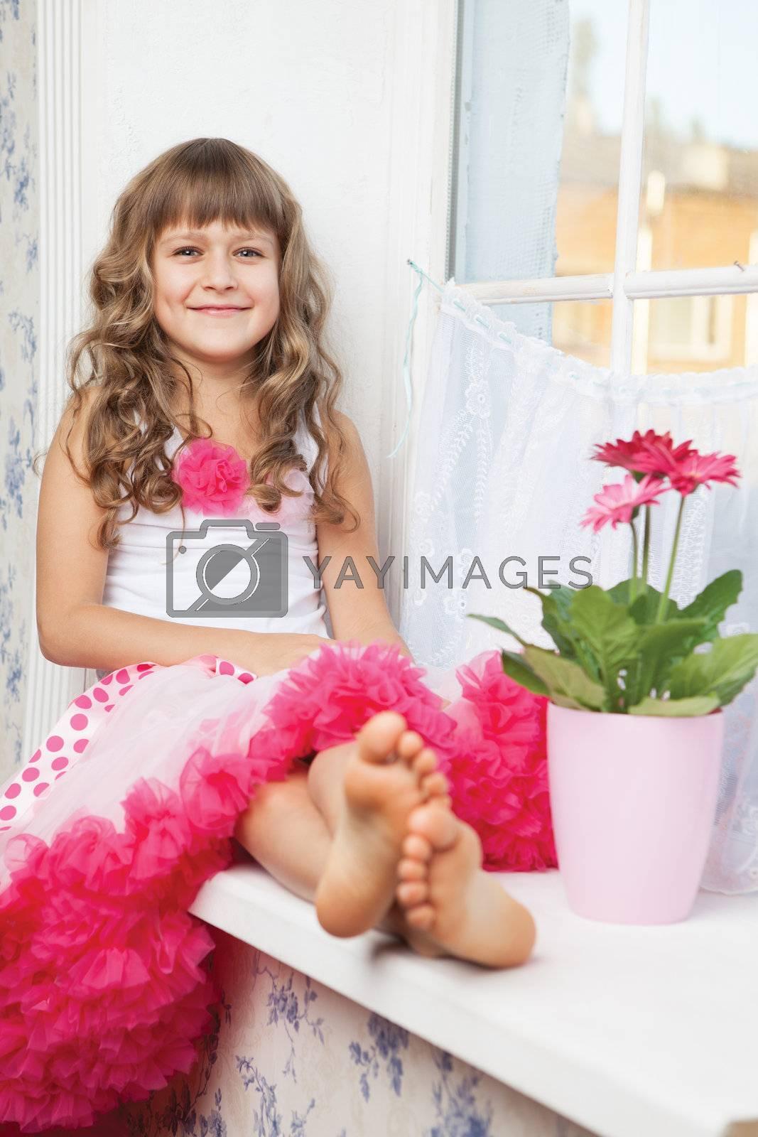 Girl teenager close-up sitting on windowsill near fresh flower by SergeyAK