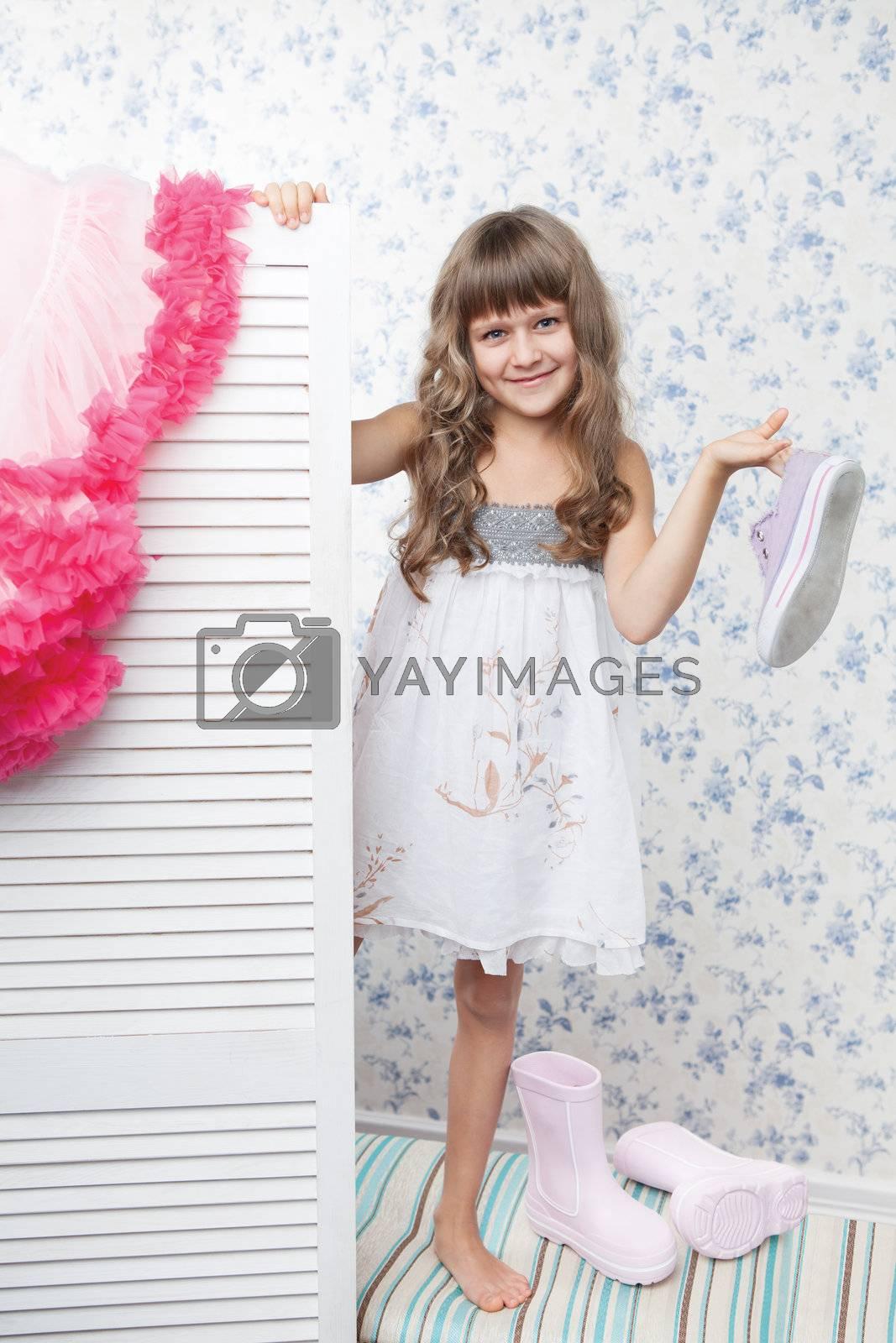 Fashion girl teenager looks out folding screen by SergeyAK
