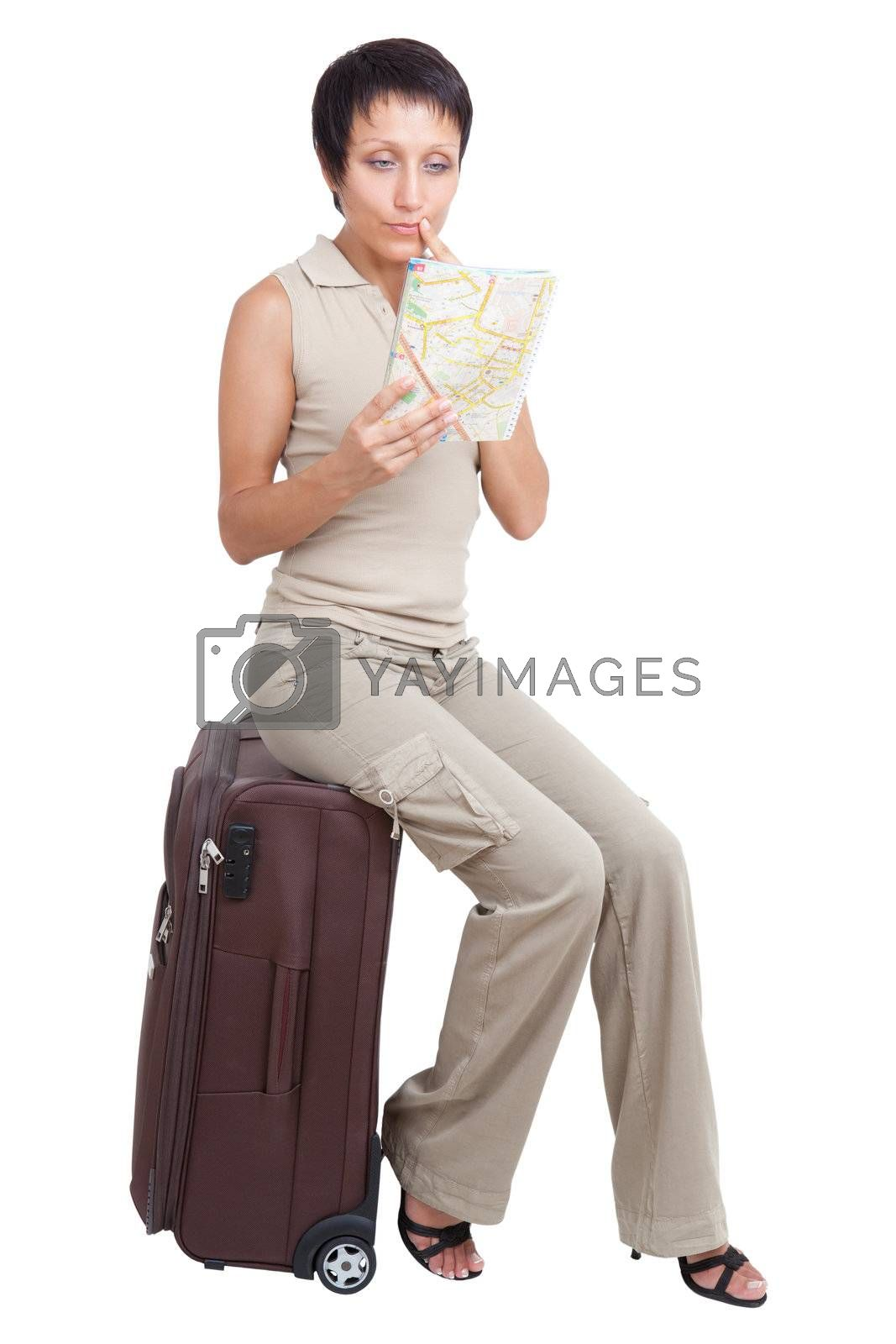 Thinking tourist woman looking at city map on suitcase isolated by SergeyAK