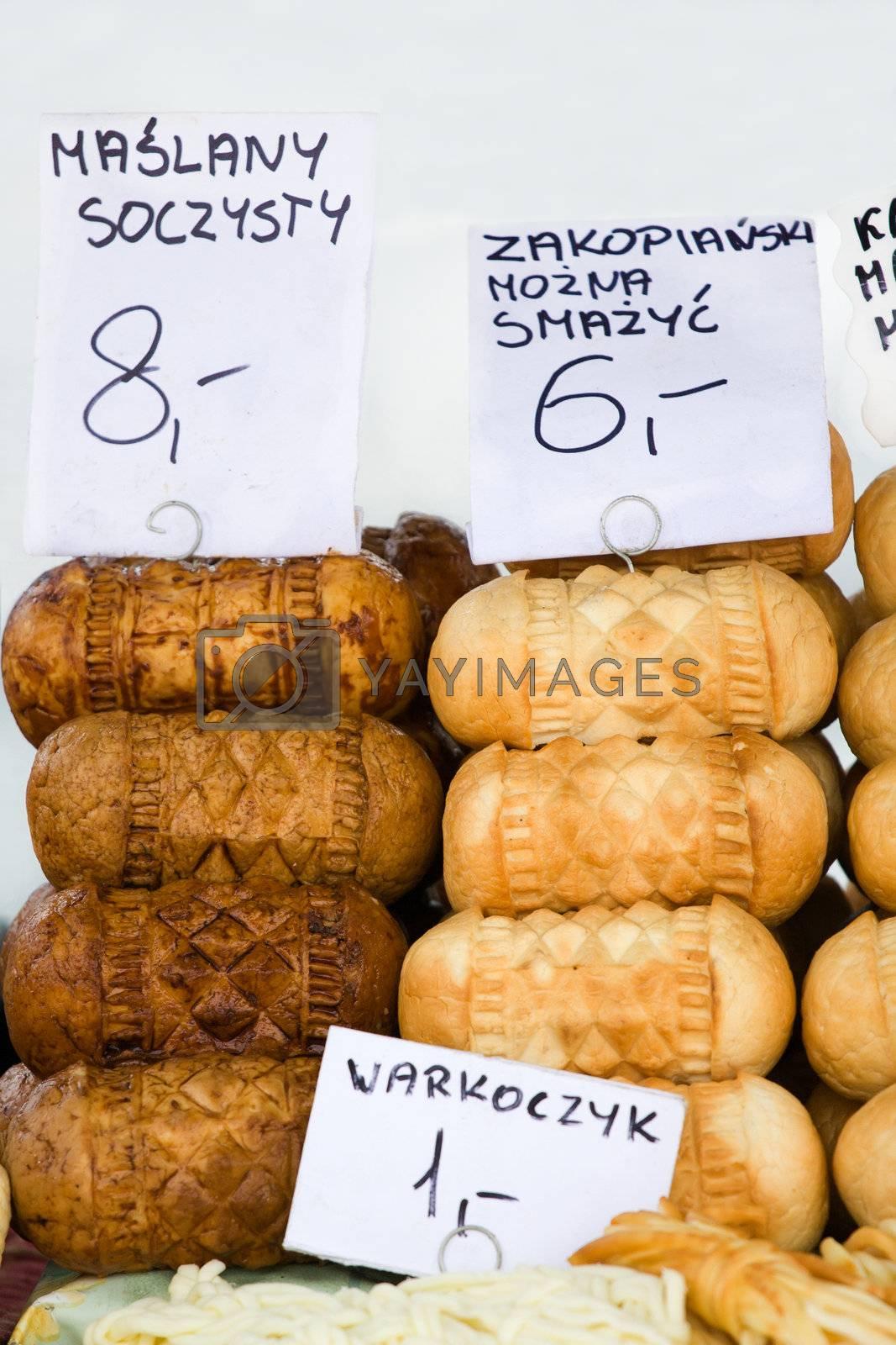 Smoked cheese Oscypki on the market in Zakopane Poland by SergeyAK