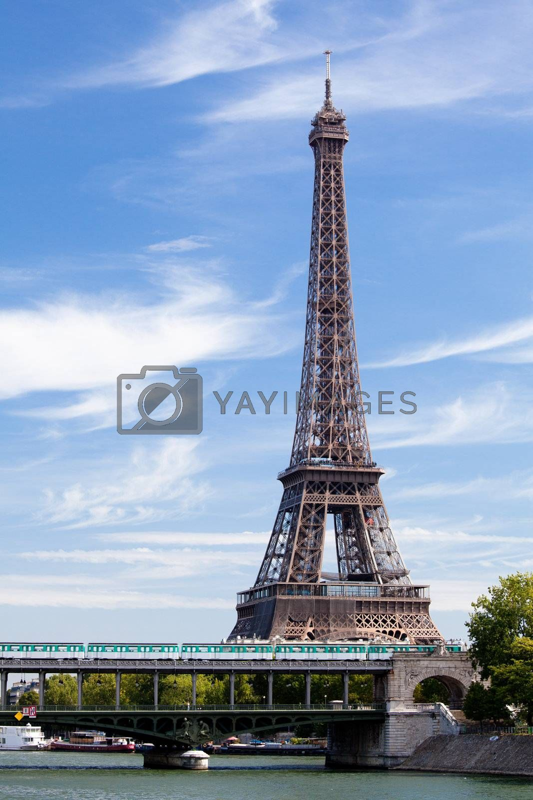 European national landmark Eiffel tower on the bank of Seine river in city Paris France on the blue sky background