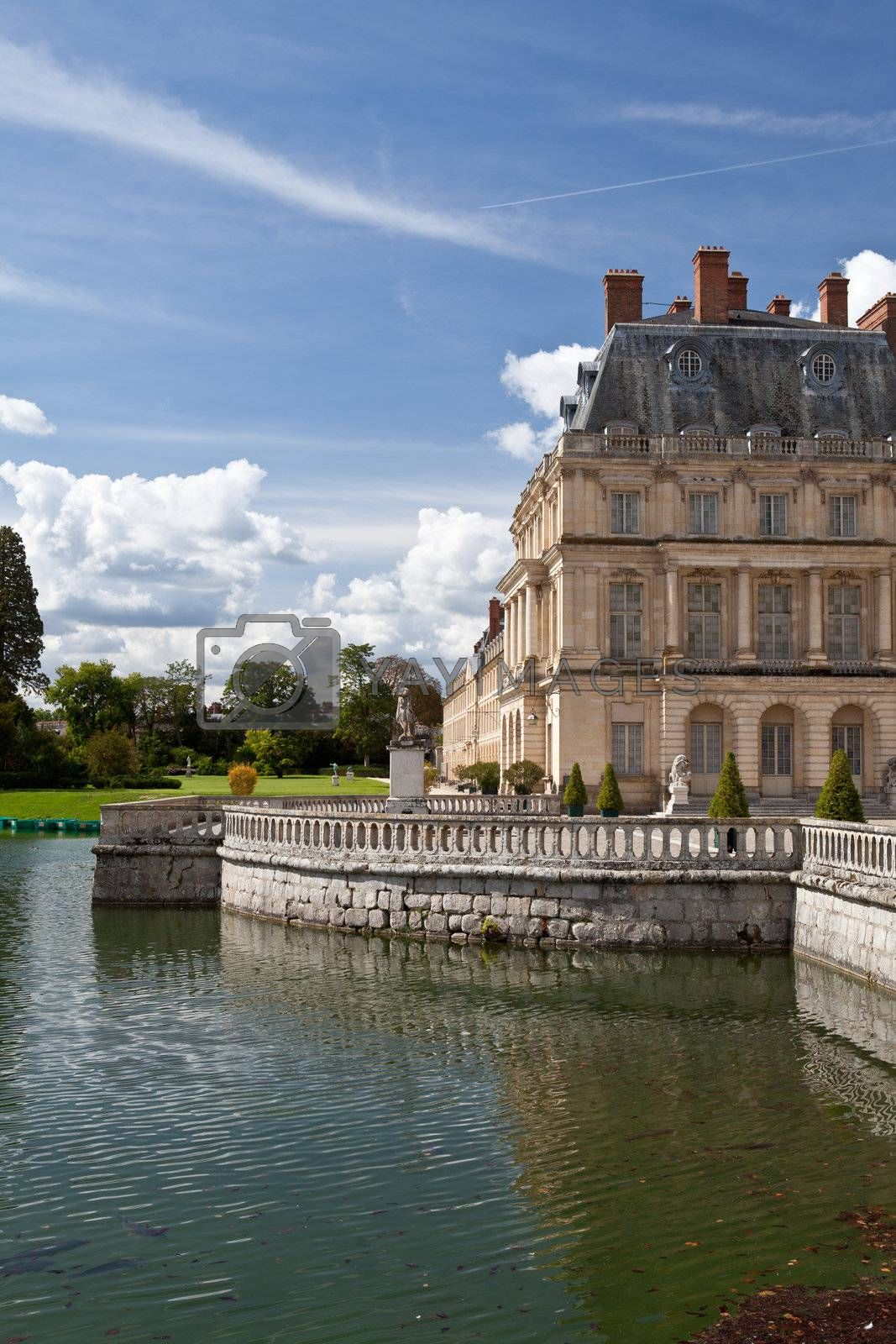 Medieval landmark royal hunting castle Fontainbleau near Paris in France and lake