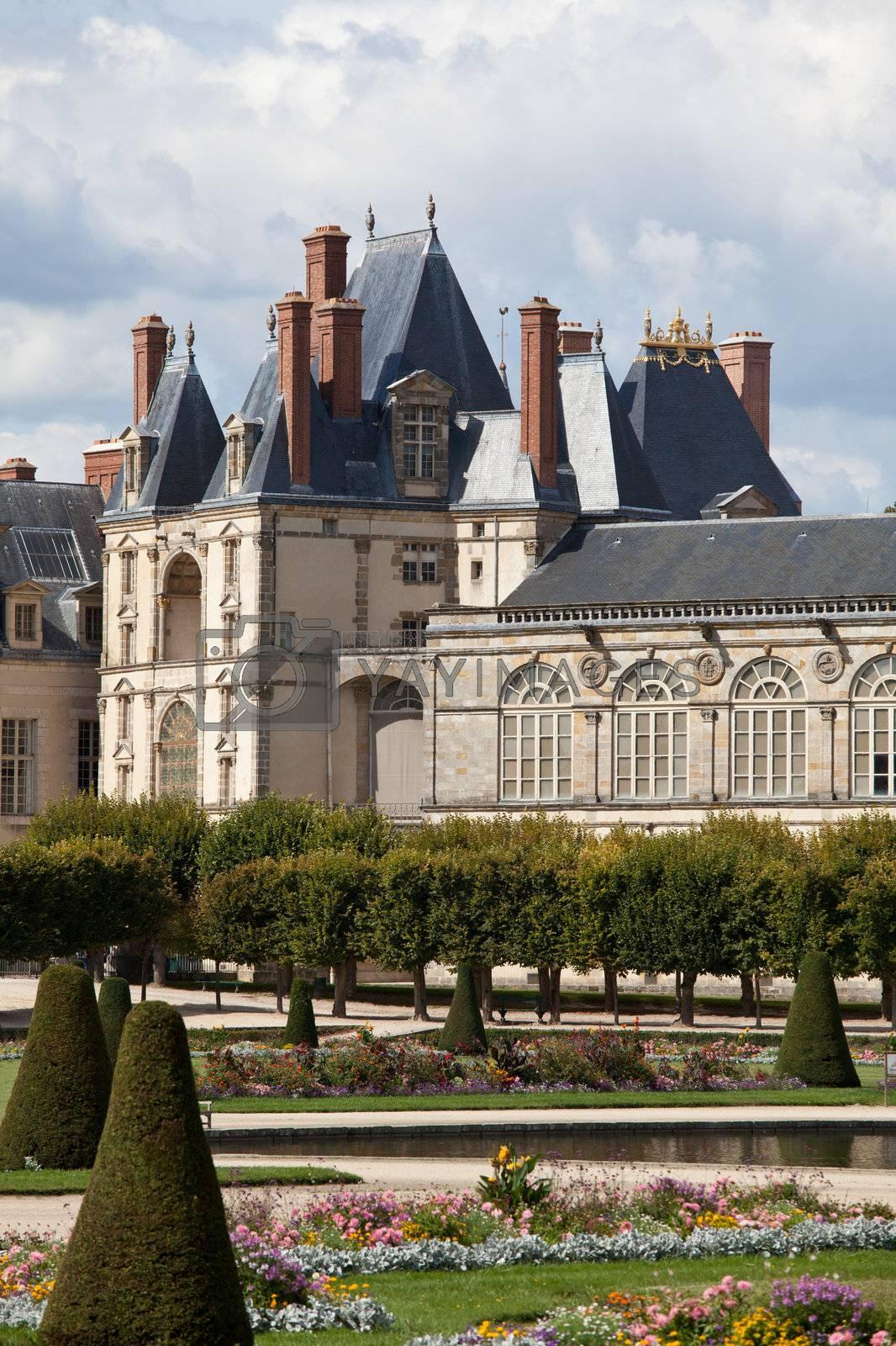 Medieval royal castle Fontainbleau near Paris in France and gard by SergeyAK