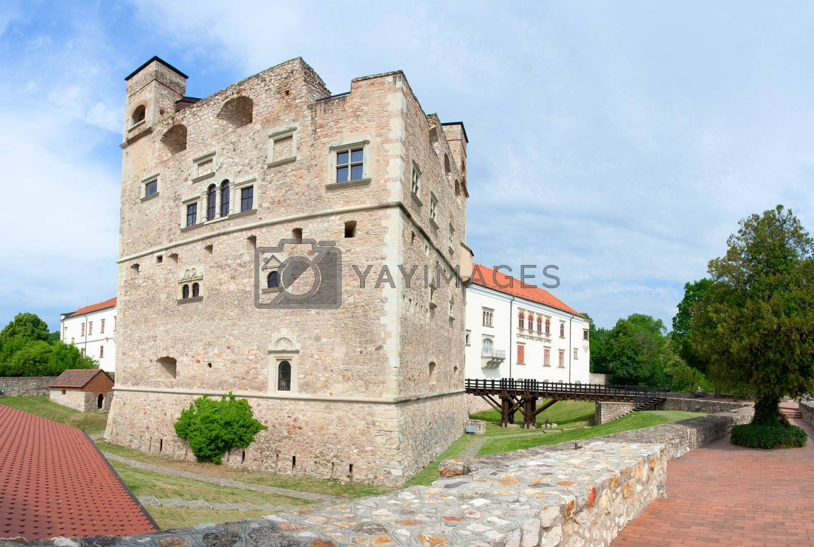 Medieval aged stone royal castle and fortress by noble family Rakoczi in Sarospatak, Borsod-Abauj-Zemplen Country, Hungary on the blue sky background