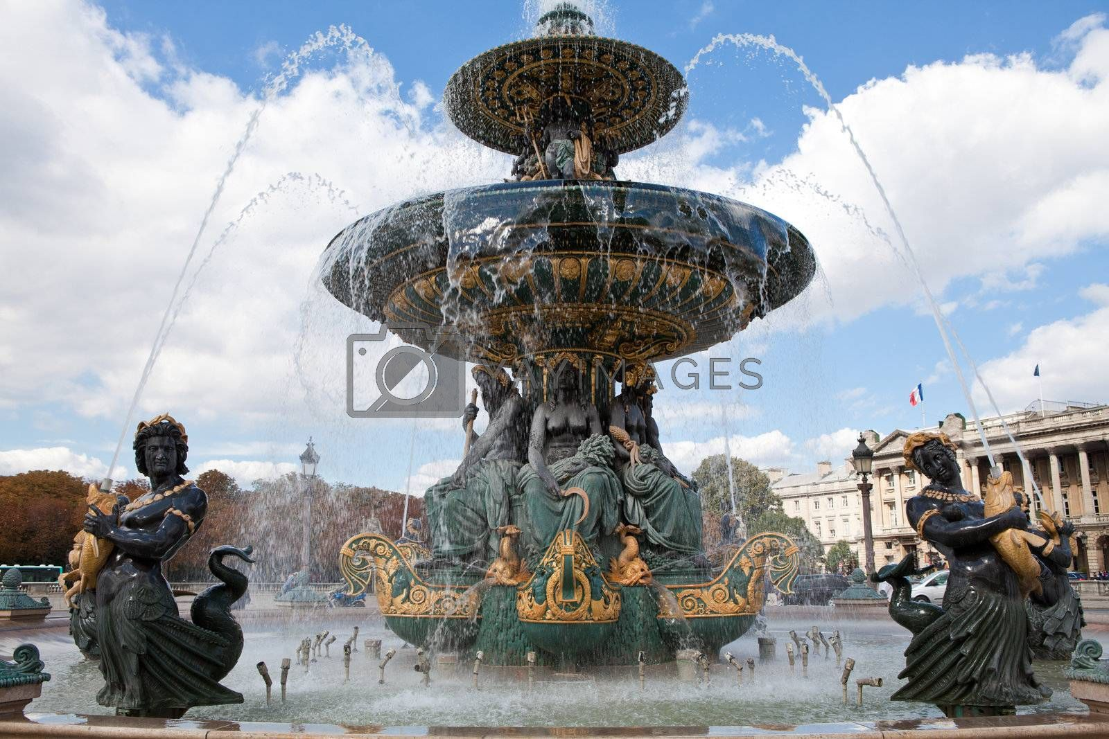 Landmark famous sculptural fountain of River Commerce and Navigation on the Place de la Concorde in Paris France on the cloudy sky background