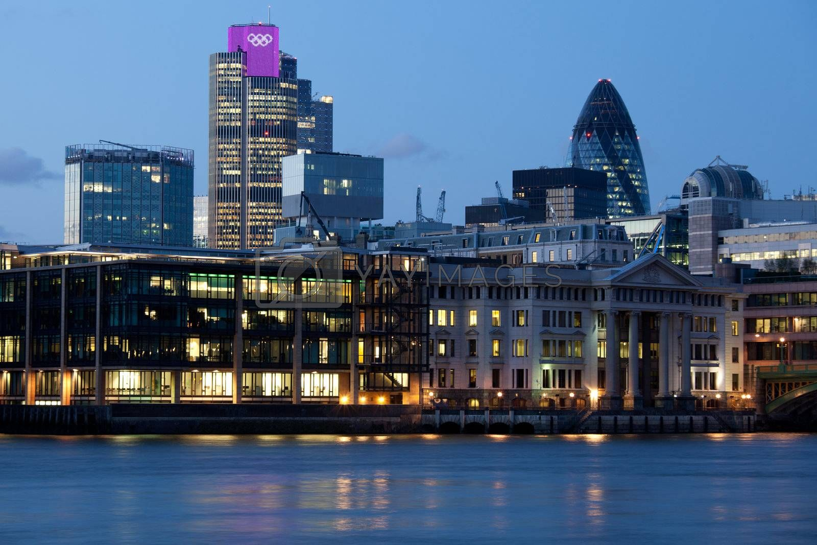London City, leading center of global finance on Thames river bank. View on Tower 42 Gherkin, illuminated with Olympic rings, Willis Building, Stock Exchange Tower and Lloyd`s of London Great Britain 2012