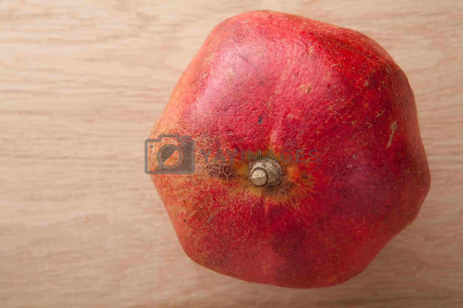 Dried pomegranate on wooden background