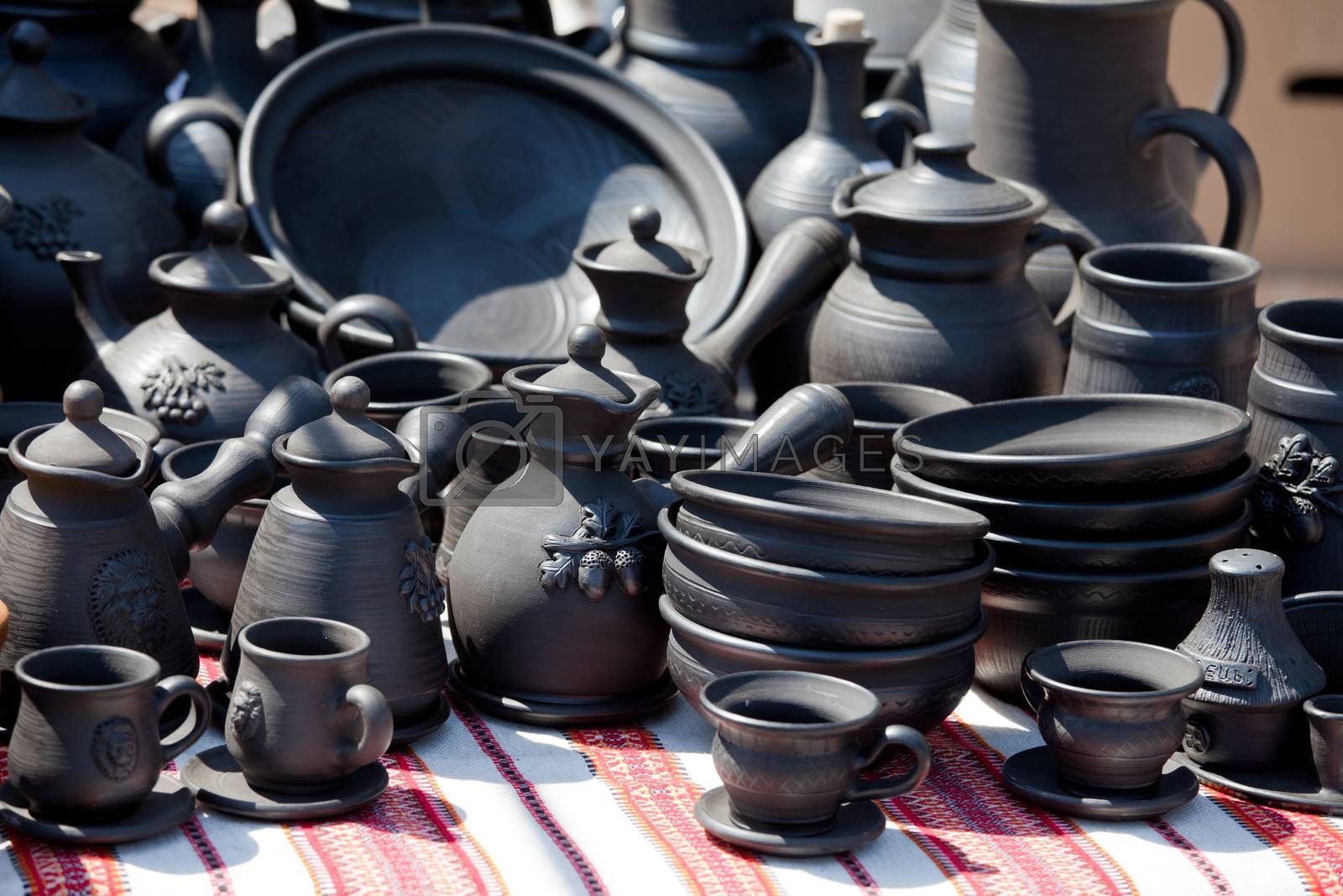 Royalty free image of Handmade ceramic pottery at street handicraft market by SergeyAK