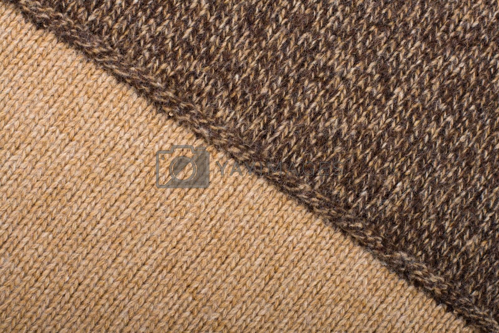 Knitted textile from two light and dark brown patterns Backgrounds Abstract