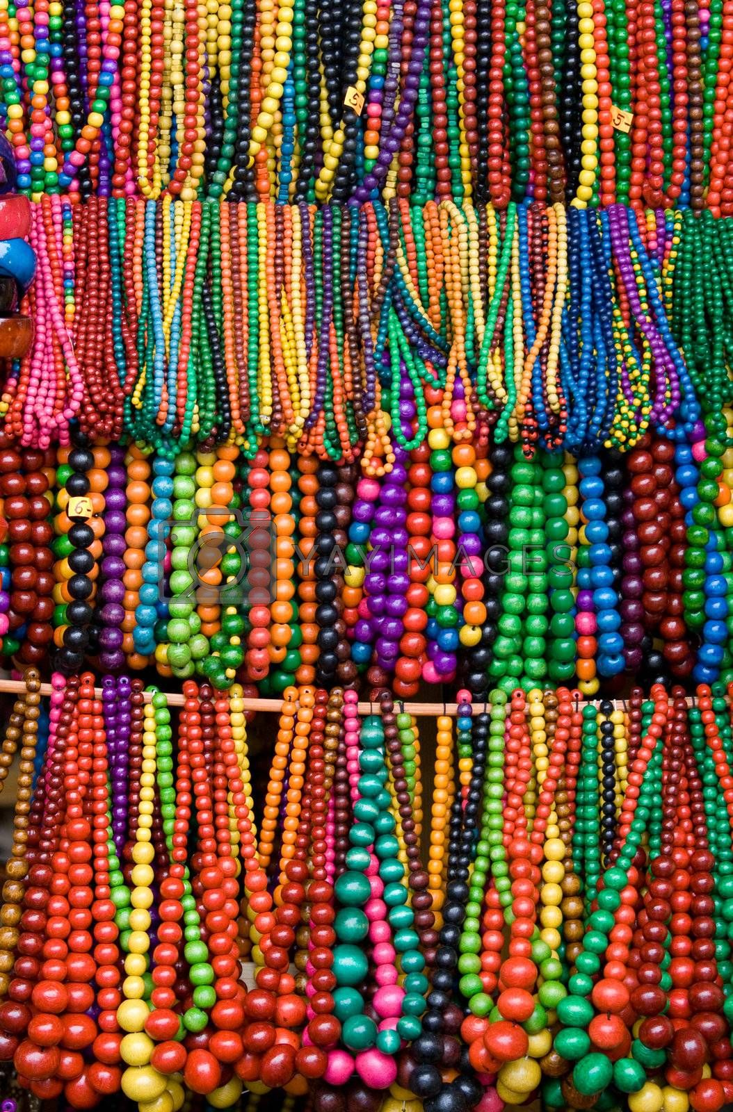 Handicraft wooden many-colored beads on the craft market