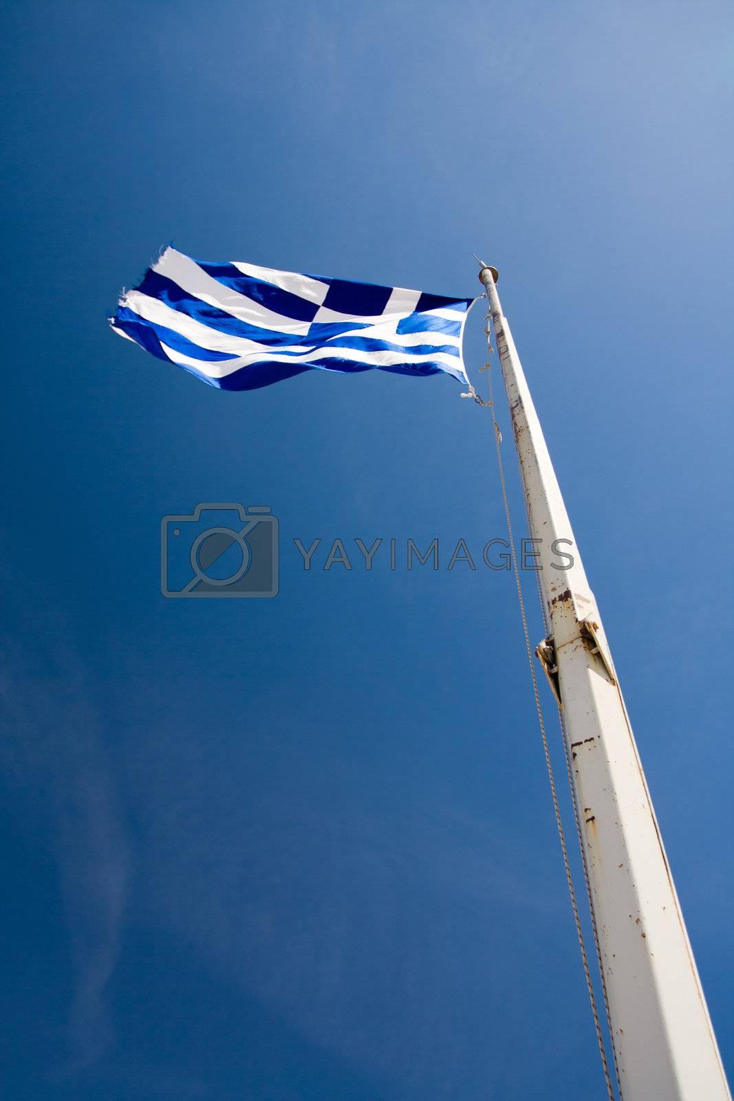 Waving Flag of Greece on the blue sky background by SergeyAK