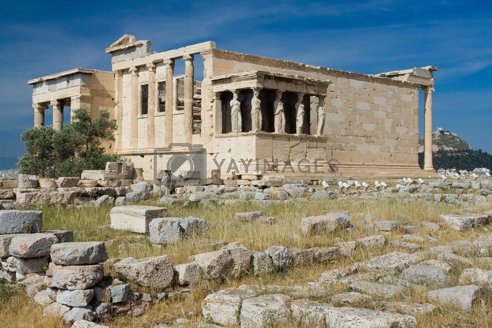 Ancient Temple Erechtheion and The Porch of the Caryatids in Acropolis Athens Greece on blue sky background